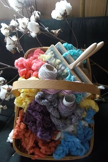 Basket of dyed cotton lint, cotton carding combs & custome blended yarn